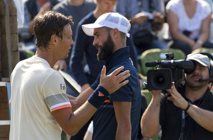 Tomas Berdych, left, Benoit Paire, right, after Berdych beats Paire at the ATP Mercedes Cup tournament in Stuttgart, Germany, Thursday, June 14, 2018. (Marijan Murat/dpa via AP)