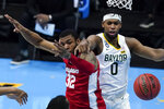 Houston forward Reggie Chaney (32) fights for a rebound with Baylor forward Flo Thamba (0) during the second half of a men's Final Four NCAA college basketball tournament semifinal game, Saturday, April 3, 2021, at Lucas Oil Stadium in Indianapolis. (AP Photo/Darron Cummings)