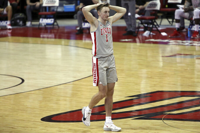 UNLV's Moses Wood (1) reacts during the second half of an NCAA college basketball game against San Diego State Wednesday, March 3, 2021, in Las Vegas. (AP Photo/Joe Buglewicz)