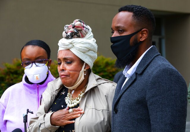 Marcia Carter-Patterson, center, mother of Manny Ellis, speaks at a press conference in front of the Pierce County Superior Court in Tacoma Thursday, June 4, 2020 regarding the killing of her son by Tacoma police. At left is Manny's sister Monet Carter-Mixon and at right is his brother Matthew Ellis. Tacoma police's restraint of Manuel Ellis caused his death the medical examiner has reported. The community has been protesting the death that happened March 3, 2020, for the past week. (Ellen M. Banner./The Seattle Times via AP)