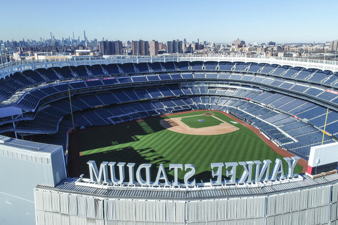 This March 26, 2020 file photo shows an empty Yankee Stadium on opening day due to COVID-19 coronavirus restrictions in the Bronx borough of New York. The Yankees and Mets would train in New York if Major League Baseball and its players try to start the coronavirus-delayed season. New York Gov. Andrew Cuomo made the announcement Saturday, June 20, 2020, and the teams confirmed the decisions. (John Woike/Samara Media via AP)