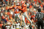 Clemson safety Nolan Turner (24) celebrates an interception with teammate Joseph Charleston (18) during the first half of an NCAA college football game against Boston College Saturday, Oct. 31, 2020, in Clemson, S.C. (Josh Morgan/Pool Photo via AP)