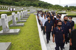 North Koreans visit the Fatherland Liberation War Martyrs Cemetery to pay respects to the monument to the fallen soldiers of the Korean People's Army in Pyongyang, North Korea, Thursday, June 25, 2020. North and South Korea on Thursday marked the 70th anniversary of the start of the Korean War with largely subdued commemorations amid the coronavirus pandemic, a day after the North abruptly halted a pressure campaign against the South. (AP Photo/Cha Song Ho)