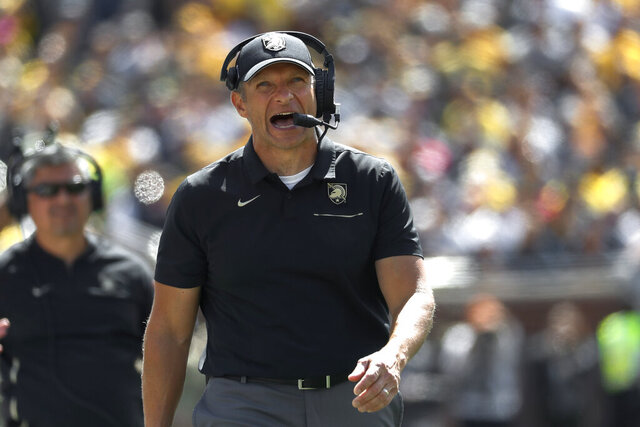 FILE - Army head coach Jeff Monken watches in the second half of an NCAA college football game against Michigan in Ann Arbor, Mich., Saturday, Sept. 7, 2019. Michigan won 24-21 in overtime. Army now has an 12-game slate, eight in the friendly confines of Michie Stadium where the Corps of Cadets will give the home team a decided advantage with no fans allowed. (AP Photo/Paul Sancya, File)