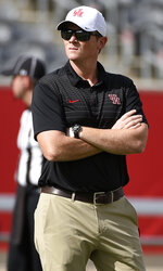 Houston head coach Major Applewhite watches warmups before an NCAA college football game against Arizona, Saturday, Sept. 8, 2018, in Houston. (AP Photo/Eric Christian Smith)