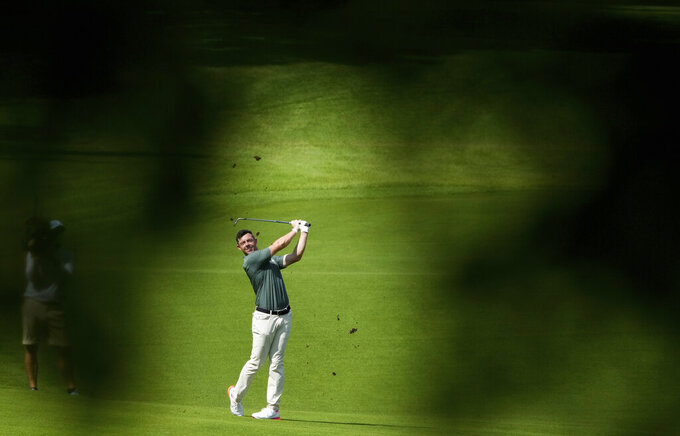 Rory McIlroy of Ireland plays a shot from the 15th fairway during the third round of the men's golf event at the 2020 Summer Olympics on Saturday, July 31, 2021, in Kawagoe, Japan. (AP Photo/Andy Wong)