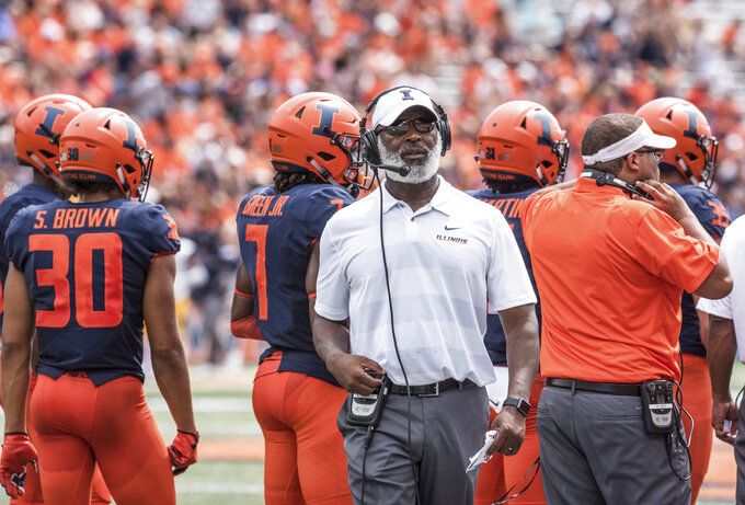 FILE - In this Sept. 1, 2018, file photo, Illinois coach Lovie Smith stands near players and coaching staff during the team's NCAA college football game against Kent State in Champaign, Ill. (AP Photo/Holly Hart, File)
