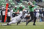 Rice's Elijah Garcia (92) beats Marshall offensive lineman Dalton Tucker (68) to force quarterback Grant Wells (8) into a bad pass during an NCAA college football game on Saturday, Dec. 5, 2020, in Huntington, W.Va.  (Sholten Singer/The Herald-Dispatch via AP)