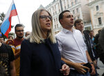Russian opposition candidate and lawyer at the Foundation for Fighting Corruption Lyubov Sobol, center, attends a protest in Moscow, Russia, Sunday, July 14, 2019. Opposition candidates who run for seats in the city legislature in September's elections have complained that authorities try to bar them from the race by questioning the validity of signatures of city residents they must collect in order to qualify for the race. (AP Photo/Pavel Golovkin)