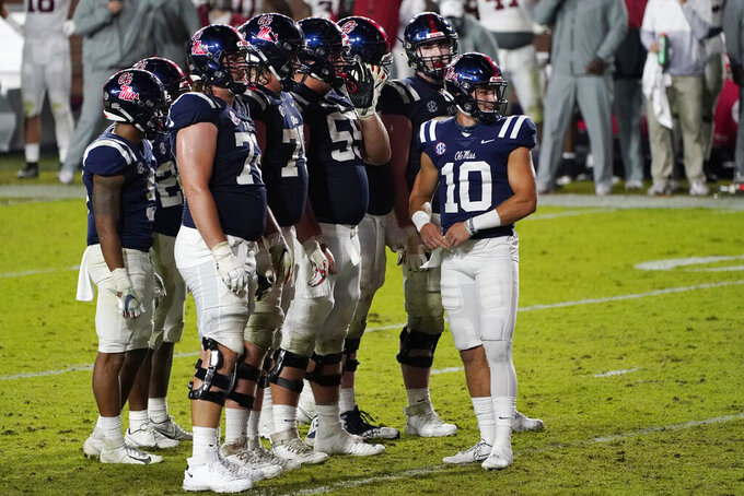 Mississippi quarterback John Rhys Plumlee (10) looks toward the Alabama defense and the end zone during the second half of an NCAA college football game in Oxford, Miss., Saturday, Oct. 10, 2020. Alabama won 63-48. (AP Photo/Rogelio V. Solis)