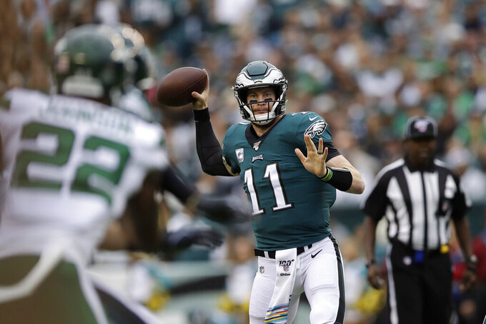 Philadelphia Eagles' Carson Wentz passes during the first half of an NFL football game against the New York Jets, Sunday, Oct. 6, 2019, in Philadelphia. (AP Photo/Matt Rourke)