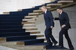 Russia's President Vladimir Putin, left, and Brazil's President Jair Bolsonaro walk to attend the meeting of the BRICS emerging economies at the Itamaraty palace in Brasilia, Brazil, Thursday, Nov. 14, 2019. (AP Photo/Pavel Golovkin, Pool)