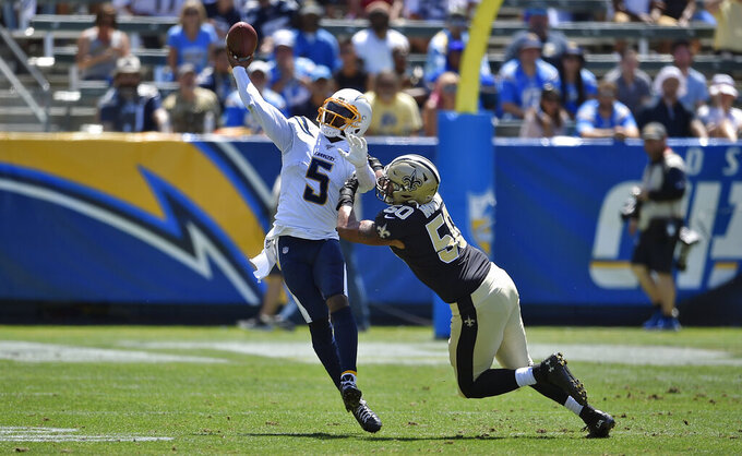 Los Angeles Chargers quarterback Tyrod Taylor (5) throws as he is pressured by New Orleans Saints defensive end Wes Horton during the first half of a preseason NFL football game Sunday, Aug. 18, 2019, in Carson, Calif. (AP Photo/Kelvin Kuo )