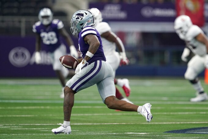 Kansas State defensive back TJ Smith (7) gains yardage after intercepting a Stanford pass in the second half of an NCAA college football game in Arlington, Texas, Saturday, Sept. 4, 2021. (AP Photo/Tony Gutierrez)