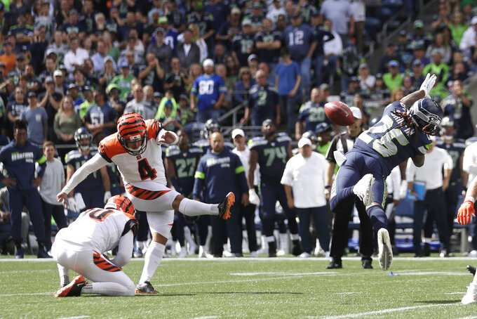 Cincinnati Bengals kicker Randy Bullock (4) kicks a field goal as Seattle Seahawks' Shaquill Griffin, right, attempts the block during the first half of an NFL football game Sunday, Sept. 8, 2019, in Seattle. (AP Photo/Stephen Brashear)