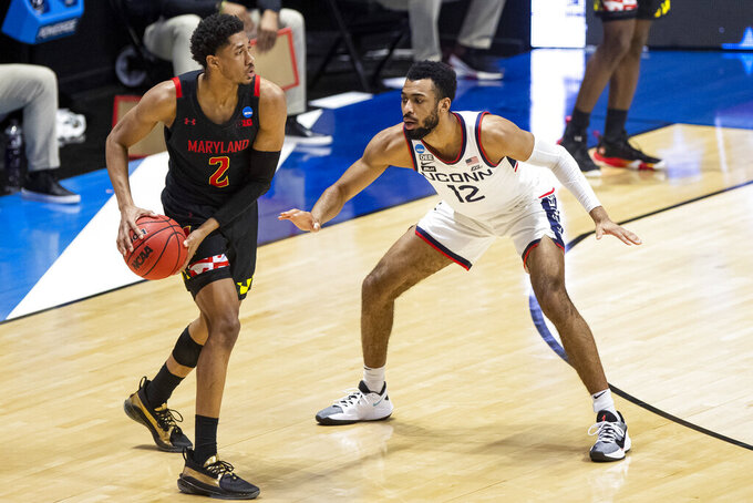 Maryland's Aaron Wiggins (2) looks to pass around Connecticut's Tyler Polley (12) during the second half of a first-round game in the NCAA men's college basketball tournament,Saturday, March 20, 2021, at Mackey Arena in West Lafayette, Ind. Maryland won 63-54. (AP Photo/Robert Franklin)