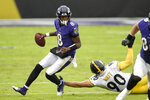 Baltimore Ravens quarterback Lamar Jackson (8) avoids a tackle by Pittsburgh Steelers outside linebacker T.J. Watt (90) during the first half of an NFL football game, Sunday, Nov. 1, 2020, in Baltimore. (AP Photo/Nick Wass)