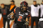 Utah running back Zack Moss (2) carries the ball against California in the first half in an NCAA college football game Saturday, Oct. 26, 2019, in Salt Lake City. (AP Photo/Rick Bowmer)