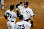 New York Yankees' Gary Sanchez celebrates hitting a three-run home run with Clint Frazier (77) and Gio Urshela (29) during the fourth inning of a baseball game against the Toronto Blue Jays on Tuesday, Sept. 15, 2020, in New York. (AP Photo/Adam Hunger)