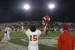 FILE - In this Friday, Dec. 16, 2016, file photo, Cathedral Catholic running back Shawn Poma celebrates after the Dons beat the St. Mary's Rams 38-35, in overtime of the Division 1AA high school football championship game in Sacramento, Calif. The California Interscholastic Federation, California's governing body for high school sports, said Monday, July 20, 2020 that the 2020-21 sports seasons will begin no earlier than December due to the coronavirus pandemic. The CIF said the normal fall, winter and spring sports seasons will be condensed into two seasons. (AP Photo/Rich Pedroncelli, File)