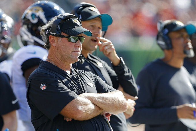 FILE - In this Oct. 20, 2019, file photo, Jacksonville Jaguars coach Doug Marrone watches during the first half of the team's NFL football game against the Cincinnati Bengals in Cincinnati. The league closed team facilities in March due to the coronavirus outbreak, sending coaches and general managers home. Marrone tried to take full advantage of the unique opportunity, sitting at the dinner table and stirring up conversations with his family on a regular basis.(AP Photo/Gary Landers, File)