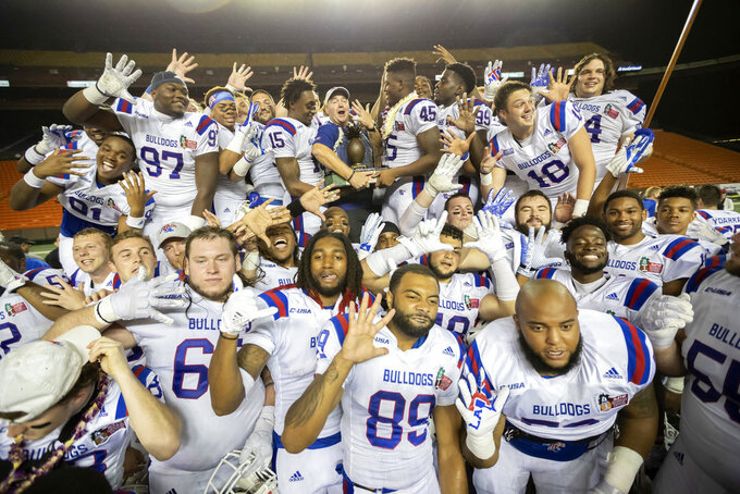 Louisiana Tech football team squeeze in for a team picture after a Hawaii Bowl NCAA college football game against Hawaii, Saturday, Dec. 22, 2018, in Honolulu. Louisiana Tech beat Hawaii 31-14. (AP Photo/Eugene Tanner)
