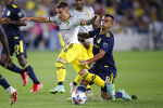 Nashville SC's Randall Leal, right, kicks the ball away from Columbus Crew's Alexandru Irinel Matan during the second half of an MLS soccer match Wednesday, July 21, 2021, in Columbus, Ohio. The game ended in a draw. (AP Photo/Jay LaPrete)