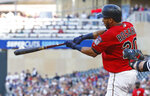 Minnesota Twins' Eddie Rosario connects with an RBI single off Chicago White Sox pitcher Reynaldo Lopez during the first inning of a baseball game Friday, May 24, 2019, in Minneapolis. (AP Photo/Jim Mone)