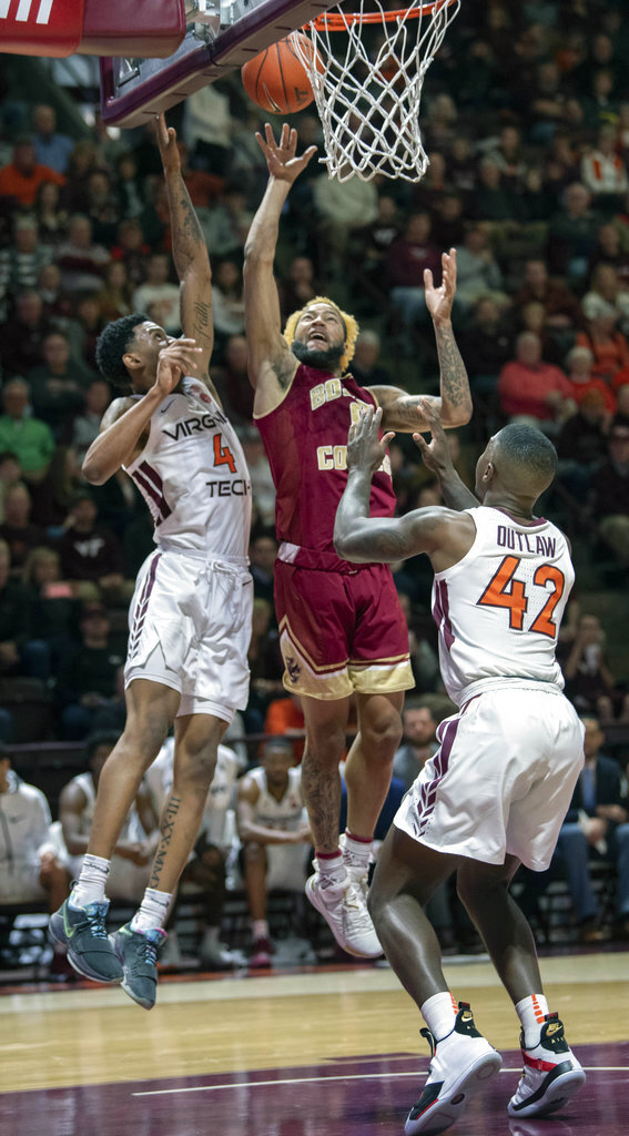 Boston College guard Ky Bowman (0) shoots a basket against Virginia Tech guards Nickeil Alexander-Walker (4) and Ty Outlaw (42) during the first half of an NCAA college basketball game Saturday, Jan. 5, 2019, in Blacksburg, Va. Va. Tech won 77-66. (AP Photo/Don Petersen)