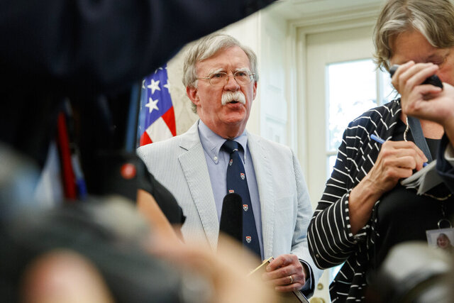 FILE - In this July 19, 2019, file photo, then-National security adviser John Bolton speaks at the request of President Donald Trump during a photo opportunity in the Oval Office of the White House in Washington. Top officials in the White House were aware in early 2019 of classified intelligence indicating Russia was secretly offering bounties to the Taliban for the deaths of Americans, a full year earlier than has been previously reported. That's according to U.S. officials with direct knowledge of the intelligence. Bolton also told colleagues he briefed Trump on the intelligence assessment in March 2019.   (AP Photo/Alex Brandon, File)