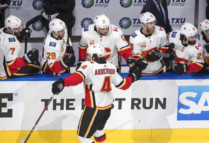 Calgary Flames' Rasmus Andersson (4) celebrates a goal against the Dallas Stars during the second period in Game 1 of an NHL hockey Stanley Cup first-round playoff series, Tuesday, Aug. 11, 2020, in Edmonton, Alberta. (Jason Franson/The Canadian Press via AP)