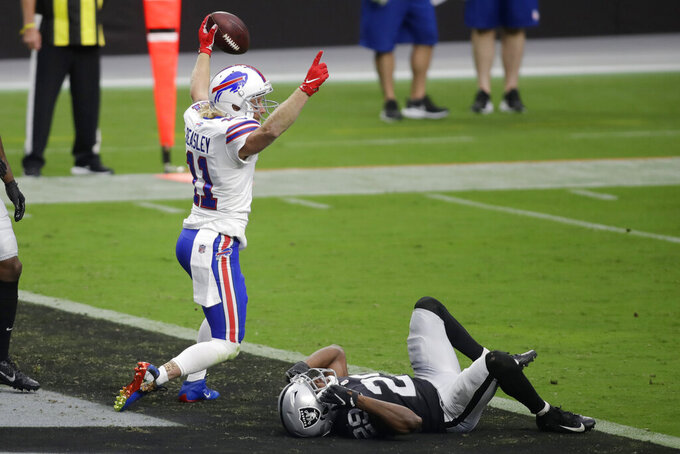 Buffalo Bills wide receiver Cole Beasley (11) celebrates after scoring a touchdown over Las Vegas Raiders free safety Lamarcus Joyner (29) during the first half of an NFL football game, Sunday, Oct. 4, 2020, in Las Vegas. (AP Photo/Isaac Brekken)