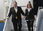 U.S. Secretary of State Mike Pompeo and his wife Suzan exit the plane as they arrive at Rafik Hariri international airport, in Beirut, Lebanon, Friday, March 22, 2019. Pompeo is in Beirut for a two day visit to meet with Lebanese officials. (AP Photo/Hussein Malla)
