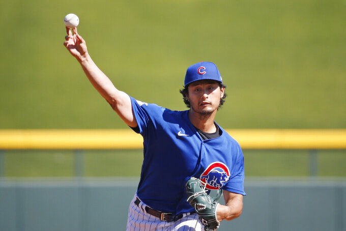Chicago Cubs' Yu Darvish pitches in a simulated game at spring training in Sloan Park, Friday, March 6, 2020, in Mesa, Ariz. Amid widespread concern about the coronavirus, Chicago Cubs pitcher Yu Darvish decided to be extra careful after he developed a cough this week. (AP Photo/Sue Ogrocki)