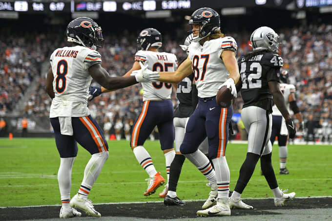 Chicago Bears running back Damien Williams (8) celebrates after tight end Jesper Horsted (87) scored a touchdown against the Las Vegas Raiders during the first half of an NFL football game, Sunday, Oct. 10, 2021, in Las Vegas. (AP Photo/David Becker)