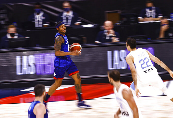 United States' Bradley Beal brings the ball up court against Argentina during the second half of an exhibition basketball game in Las Vegas on Tuesday, July 13, 2021. (Chase Stevens/Las Vegas Review-Journal via AP)