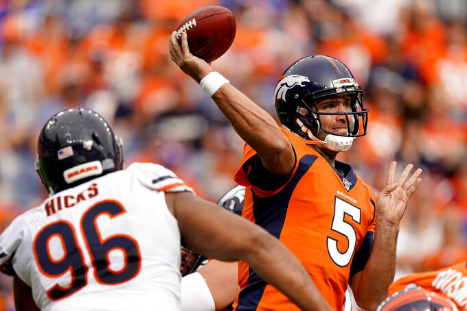 Denver Broncos quarterback Joe Flacco (5) throws under pressure from Chicago Bears defensive tackle Akiem Hicks (96) during the second half of an NFL football game, Sunday, Sept. 15, 2019, in Denver. (AP Photo/Jack Dempsey)