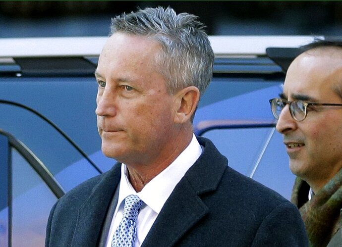 FILE - In this March 12, 2019 file photo, Martin Fox, from a private tennis academy in Houston, arrives at federal court in Boston to face charges in a nationwide college admissions bribery scandal. Fox pleaded guilty in October and is scheduled to be sentenced on Friday, Nov. 15. (AP Photo/Steven Senne, File)