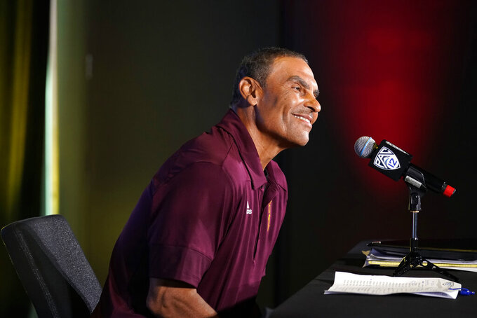 FILE - Arizona State head coach Herm Edwards answers questions during the Pac-12 Conference NCAA college football Media Day in Los Angeles, in this Tuesday, July 27, 2021, file photo. Herm Edwards has done a solid job in three seasons since taking over as Arizona State's coach. This season, with a roster primarily made up of players he recruited, the 25th-ranked Sun Devils are expected to take the next step. (AP Photo/Marcio Jose Sanchez, File)