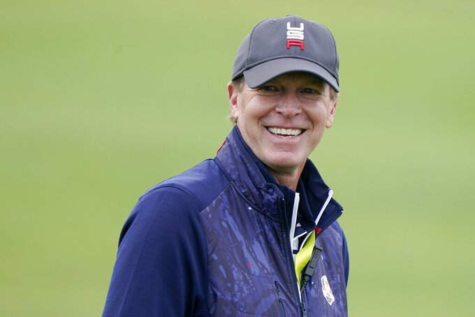 Team USA captain Steve Stricker smiles during a practice day at the Ryder Cup at the Whistling Straits Golf Course Tuesday, Sept. 21, 2021, in Sheboygan, Wis. (AP Photo/Charlie Neibergall)