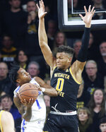 Wichita State's Dexter Dennis (0) defends against Memphis guard Tyler Harris during the first half of an NCAA college basketball game Thursday, Jan. 9, 2020, in Wichita, Kan. (Travis Heying/The Wichita Eagle via AP)