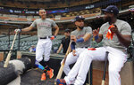 Houston Astros shortstop Carlos Correa, left, catcher Robinson Chirinos, center, and left fielder Yordan Alvarez, right, wait to take batting practice during a team workout, Thursday, Oct. 3, 2019, in Houston. The Astros will host the Tampa Bay Rays in the first game of an American League Division Series baseball game Friday. (AP Photo/Eric Gay)