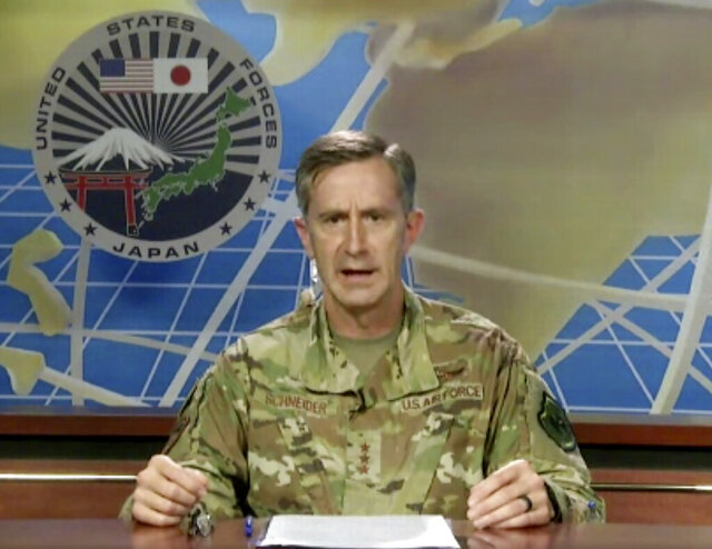 In this image made from an online news conference provided by U.S. Forces Japan, Lt. Gen. Kevin Schneider, Commander of the U.S. Force, speaks from Yokota Air Base, in Tokyo, to reporters, Wednesday, July 29, 2020. Schneider said Wednesday strict measures were in place among his ranks to curb the spread of the coronavirus by military service personnel entering Japan.(U.S. Forces Japan. via AP)