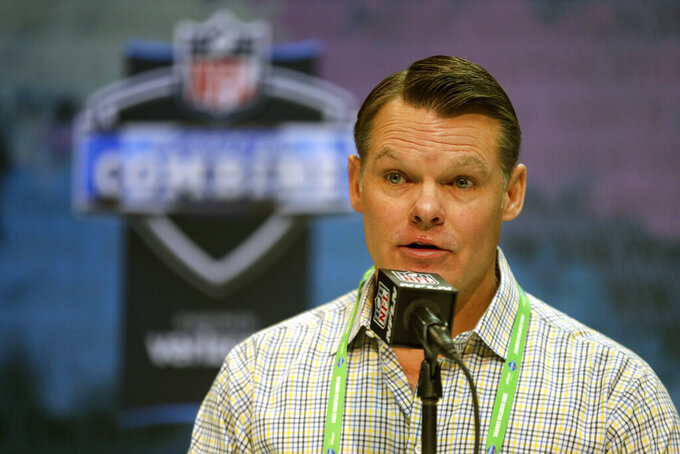 FILE - Indianapolis Colts general manager Chris Ballard speaks during a press conference at the NFL football scouting combine in Indianapolis, in this Tuesday, Feb. 25, 2020, file photo. With his team facing major holes at left tackle and edge rusher heading into next week's NFL Draft in Cleveland, April 29-May 1, 2021, Indianapolis Colts owner Jim Irsay hopes to fill one need with the No. 21 overall pick and the other over the final six rounds. But Irsay isn't tipping his hand about which way — or perhaps a third way — the Colts are leaning, certainly not with general manager Chris Ballard calling the shots. (AP Photo/Michael Conroy, File)