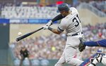 New York Yankees' Aaron Hicks hits an RBI single off Minnesota Twins pitcher Jake Odorizzi in the fourth inning of a baseball game Wednesday, July 24, 2019, in Minneapolis. (AP Photo/Jim Mone)