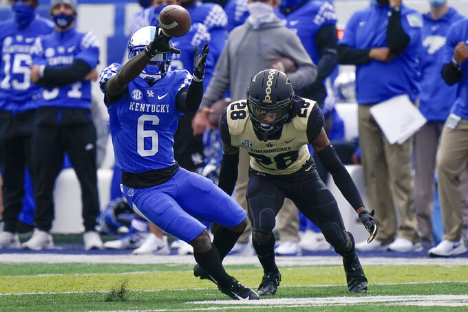 Kentucky wide receiver Josh Ali (6) catches a pass during the first half of an NCAA college football game against Vanderbilt, Saturday, Nov. 14, 2020, in Lexington, Ky. (AP Photo/Bryan Woolston)