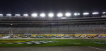 Drivers get a green flag during the NASCAR Truck Series auto race at Las Vegas Motor Speedway, empty of fans because of COVID-19, Friday, Sept. 25, 2020, in Las Vegas. (Ellen Schmidt/Las Vegas Review-Journal via AP)