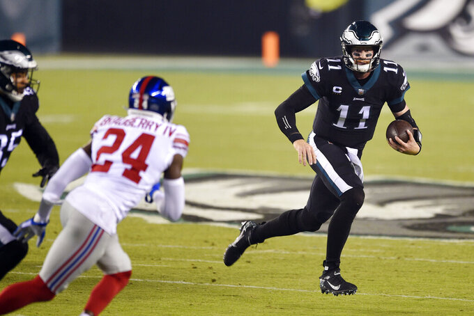 Philadelphia Eagles' Carson Wentz scrambles during the first half of an NFL football game against the New York Giants, Thursday, Oct. 22, 2020, in Philadelphia. (AP Photo/Derik Hamilton)