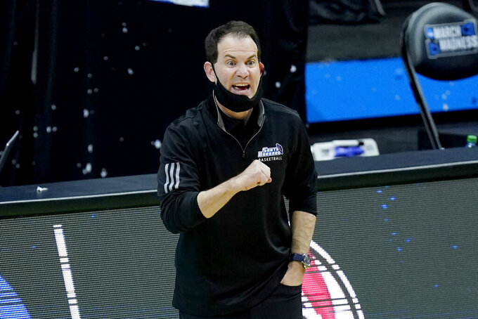 UC Santa Barbara head coach Joe Pasternack directs his players during the first half of a college basketball game against Creighton in the first round of the NCAA tournament at Lucas Oil Stadium in Indianapolis Saturday, March 20, 2021. (AP Photo/Mark Humphrey)
