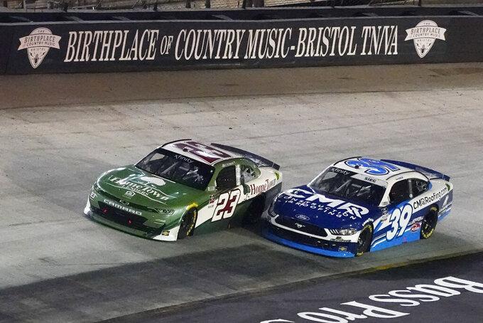 Ty Dillon (23) and Ryan Sieg (39) come through a turn during a NASCAR Xfinity Series auto race at Bristol Motor Speedway Friday, Sept. 17, 2021, in Bristol, Tenn. (AP Photo/Mark Humphrey)